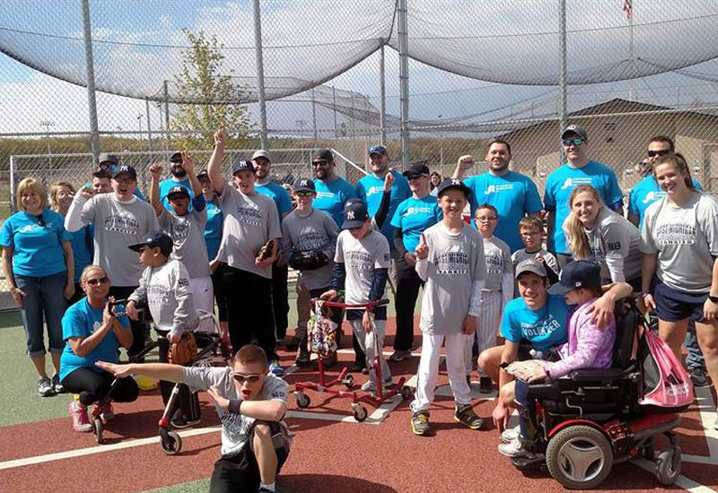 AgroupofJRAutomationemployeesvolunteerwithWestMichiganMiracleLeagueanon-profitorganizationthatenableschildrenwithphysicalandmentaldisabilitiestoplaybaseball