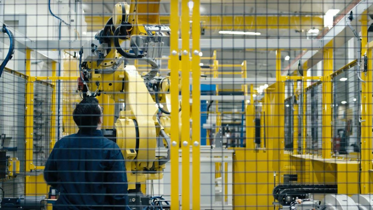 JR Automation employee observing an Automation Robot